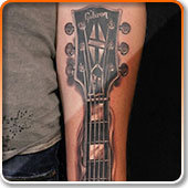 20 kick ass guitar tattoos. Black Bedroom Furniture Sets. Home Design Ideas