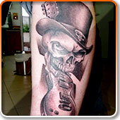 Skull and Guitar Tattoo